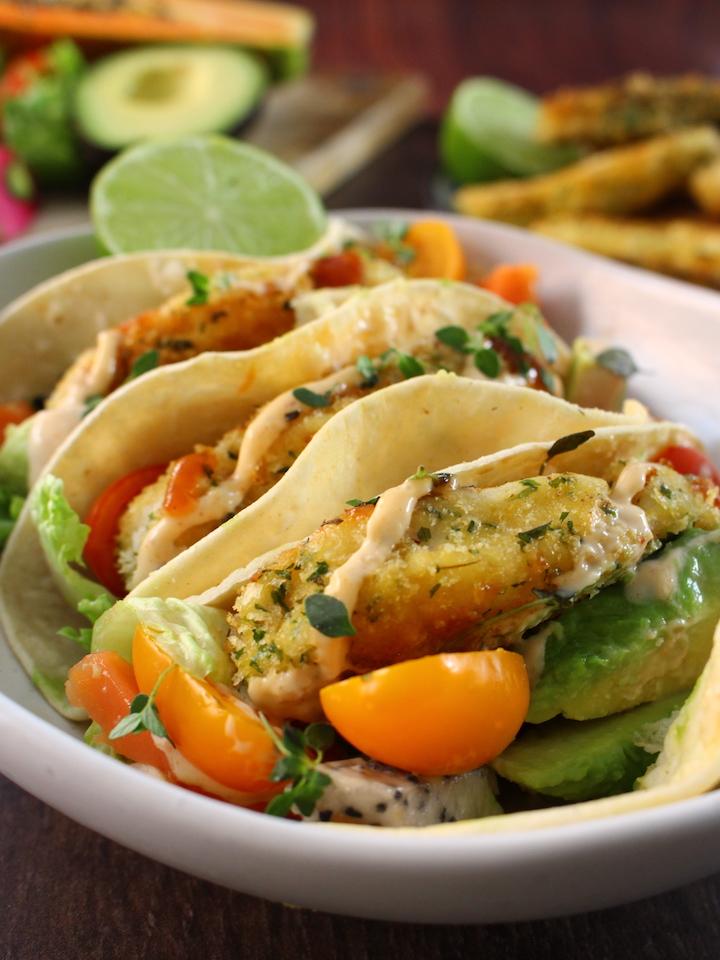 Breaded blue grenadier (fish) tacos with papaya, avocado, dragon fruit & cherry tomato